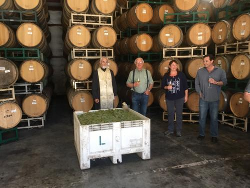 First Crush at Lucas & Lewellen Vineyards - image of winemaker, owners, and Father John Finley blessing the grapes