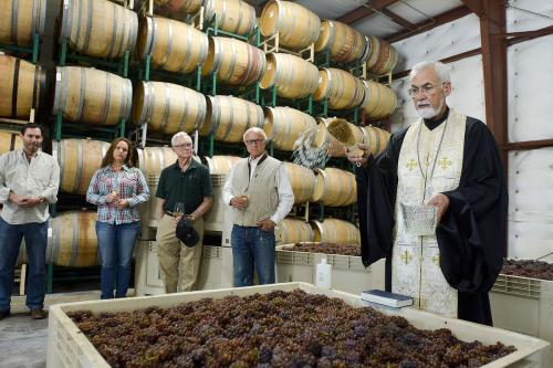 Father John Finley blesses the first fruits of harvest at the Lucas & Lewellen Vineyards first crush