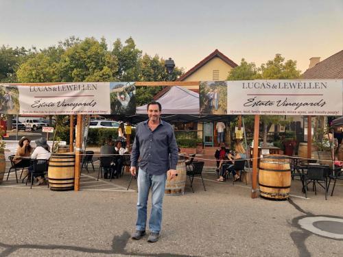 Mike Lewellen at Lucas & Lewellen Vineyards - outdoor wine tasting