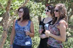 A photo of Wine Club members on a tour of Lucas & Lewellen vineyards