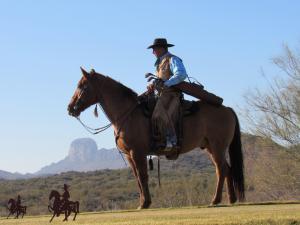 Los Caballeros Dude Ranch cowboy golfer