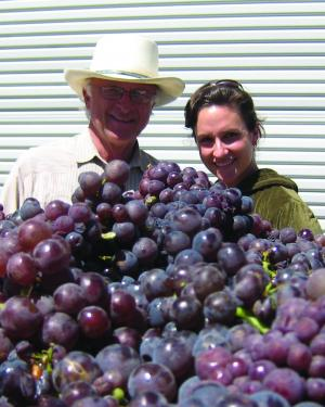 Louis Lucas and winemaker Megan McGrath Gates at a harvest years ago when they did not have to wear masks!