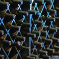 A photo of a wine cellar with wines stacked in a rack